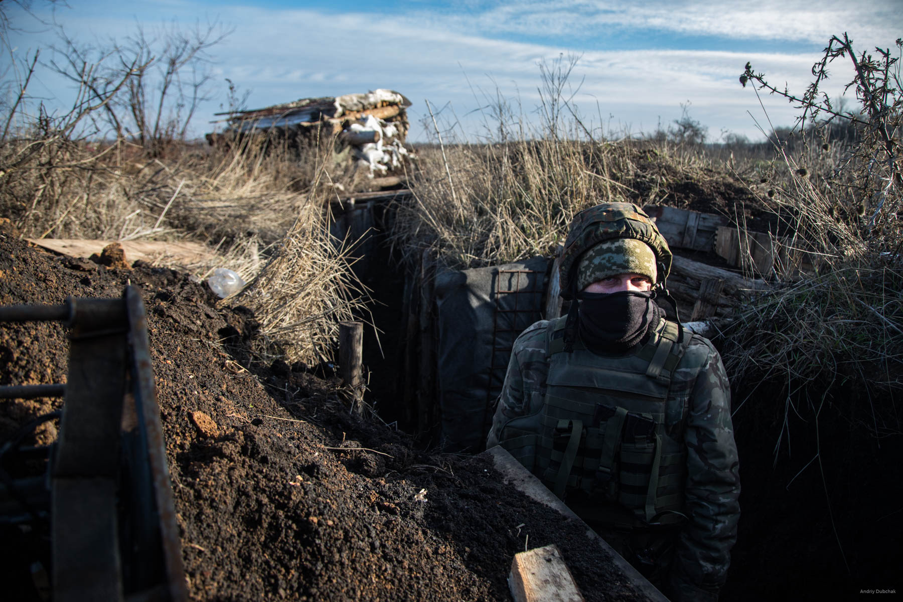 A fighter in the line of trenches at the front, near Popanskaya, December 2017.