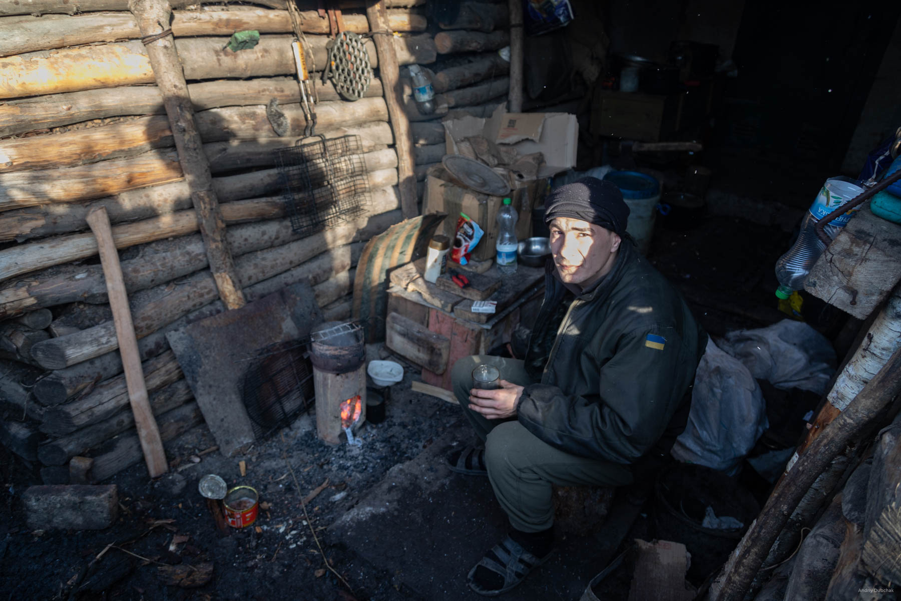 A fighter is drinking tea in the dugout-observer, near Popasnaya, December 2017.