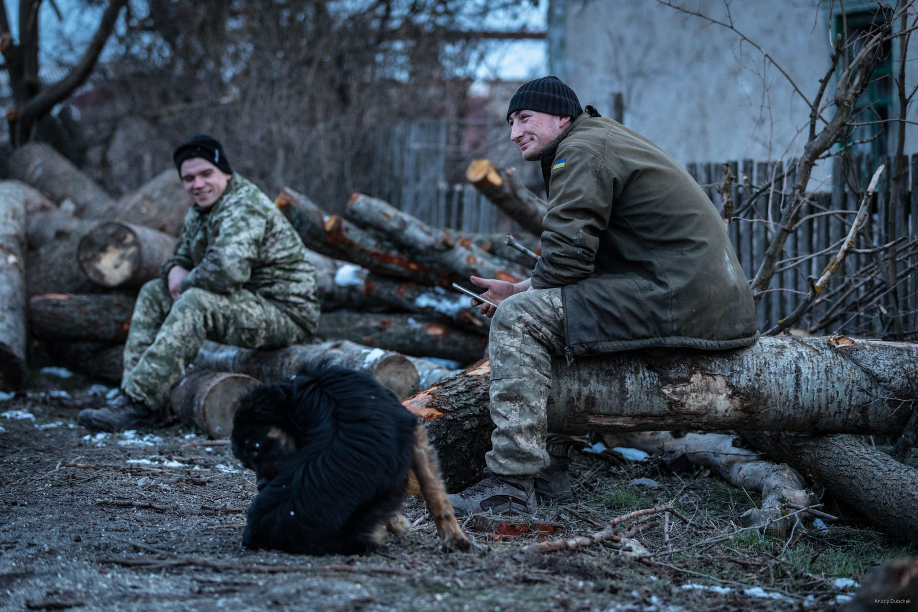 Driver, Vasily, and sailor, Dmitry, rest after harvesting firewood. Shirokine, March 2018.