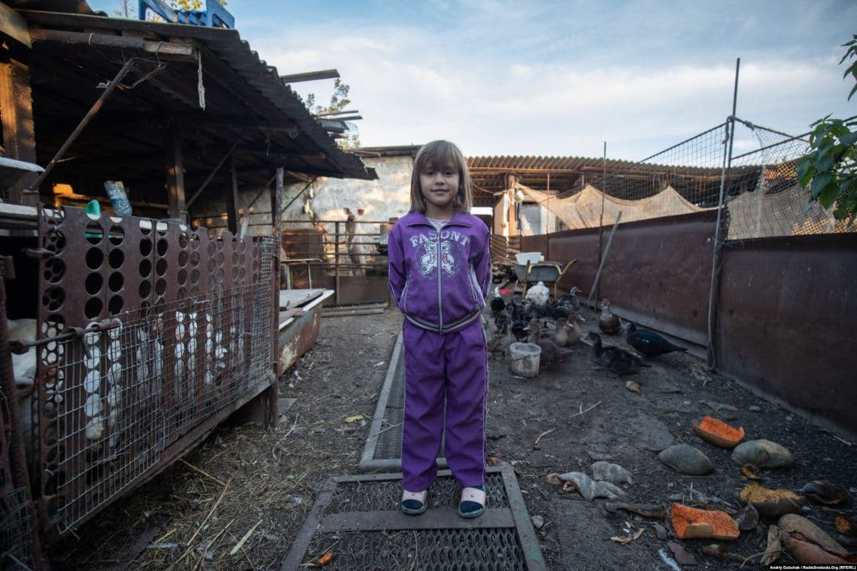 Sabrina, 7, on her family's farm in Pavlopil (photo: Andriy Dubchak)