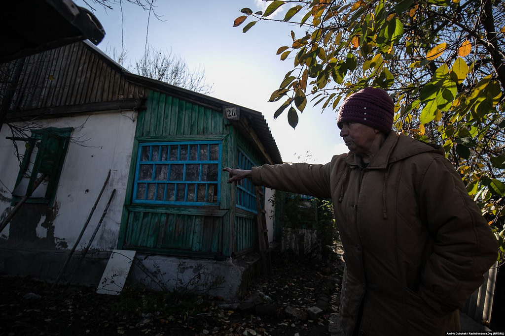 71-year-old Liubov Semenivna shows us the bullet holes fired on the walls of her house a few days ago (October 28). The 7.62 caliber bullets hit the walls and the roof (Ukraine reporter Andriy Dubchak)