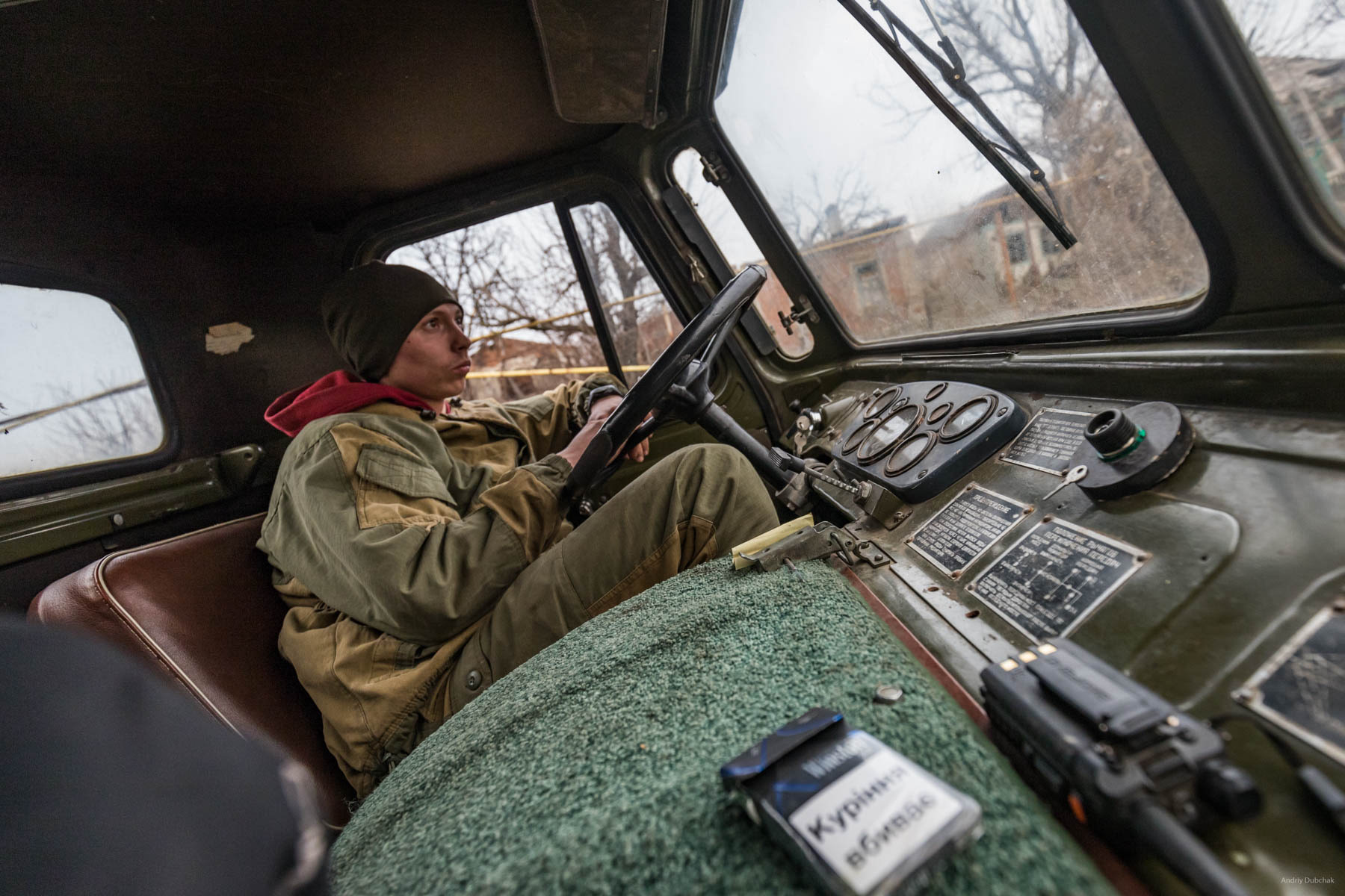 "On his ""Shishiha,""Driver, Vitaliy, (23 years old, native of Cherkassy region) delivered firewood to one of the front positions. In Shirokine, it was his second rotation. The front driver is a dangerous military profession, since transport is one of the main targets of gunfire, and the enemy shoots through the entrances to the front positions from all types of weapons. The main advice from Vitaly was - never panic! Shirokine, March 2018."