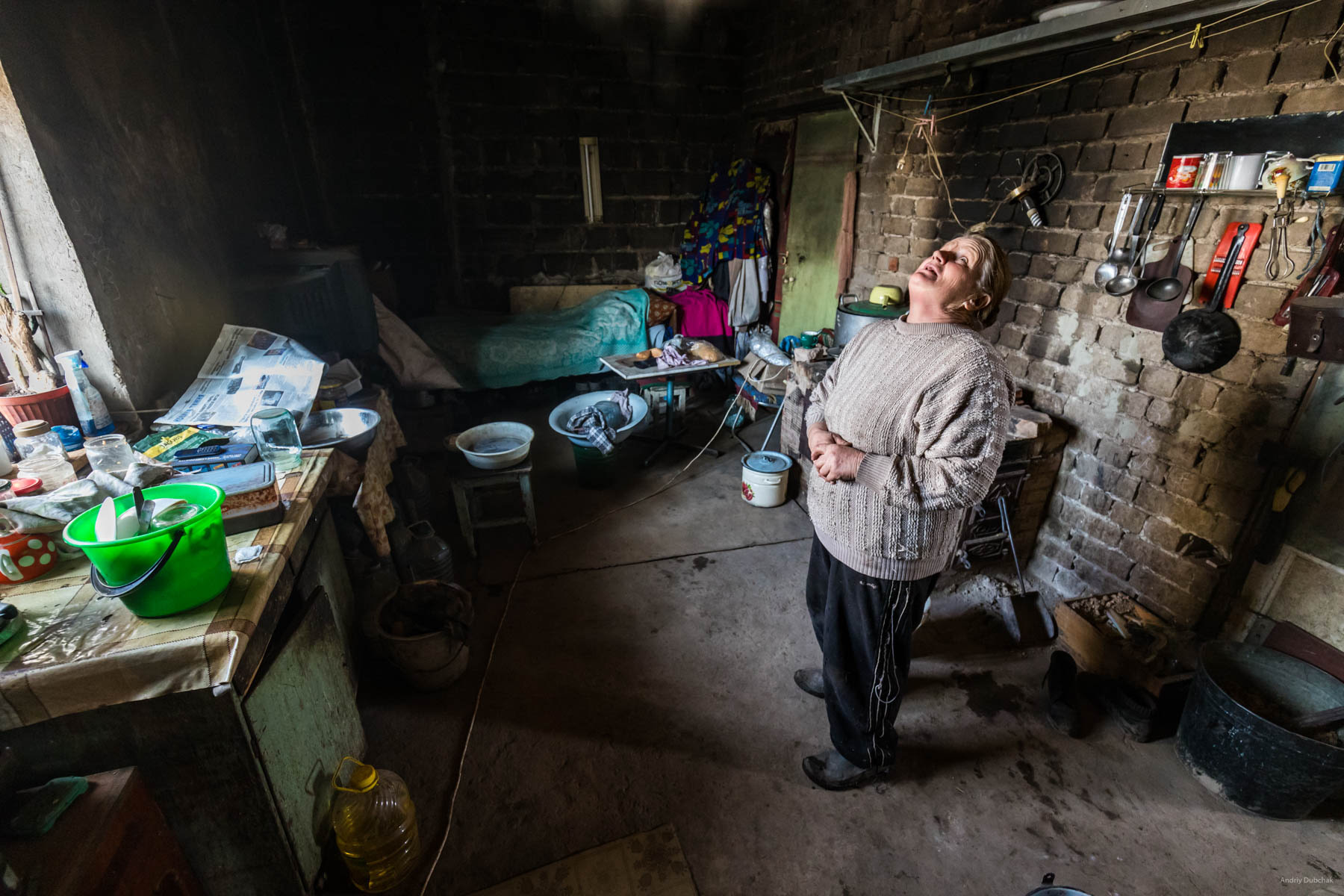"In Vodyane, Spring of 2018, seven families were permanently residing (10 people). They farmed the land, raised livestock - goats (milk that they sold or changed for food from soldiers), pigs and poultry. Only a small amount of assistance was received from international humanitarian organizations. There was no separate assistance from the Ukrainian state.  One of them is baba ""Zoya"" (military called the woman that way). The husband and son of the woman died, she lived alone. After the fighting began, other her relatives - daughter - and the four grandchildren left for Russia. Marine_22.jpg"