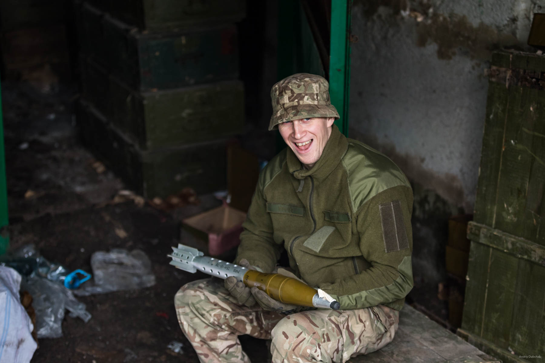 "A warrior of the marines, Andrew, with a ""gift"" for militants on the front, near Mariupol. In his hands - a charge for a ""boot"", (SPG - tripod-mounted man-portable antitank gun). This can hit both armor and fortifications (depending on the warhead). Maximum range is 4500 m, the point-blank range is 800 m, the target range is 1300 m. Vodyane, March 2018."