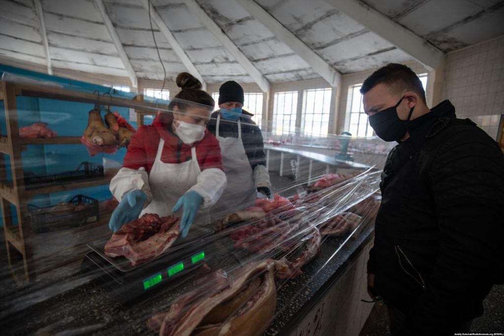 "At a butcher's shop, residents of Kalynivka told RFE/RL that the Ukrainian government was providing financial support to some workers until April 26. ""What comes next is unknown,"" one worried resident said.  Photographer Andriy Dubchak / Ukraine"