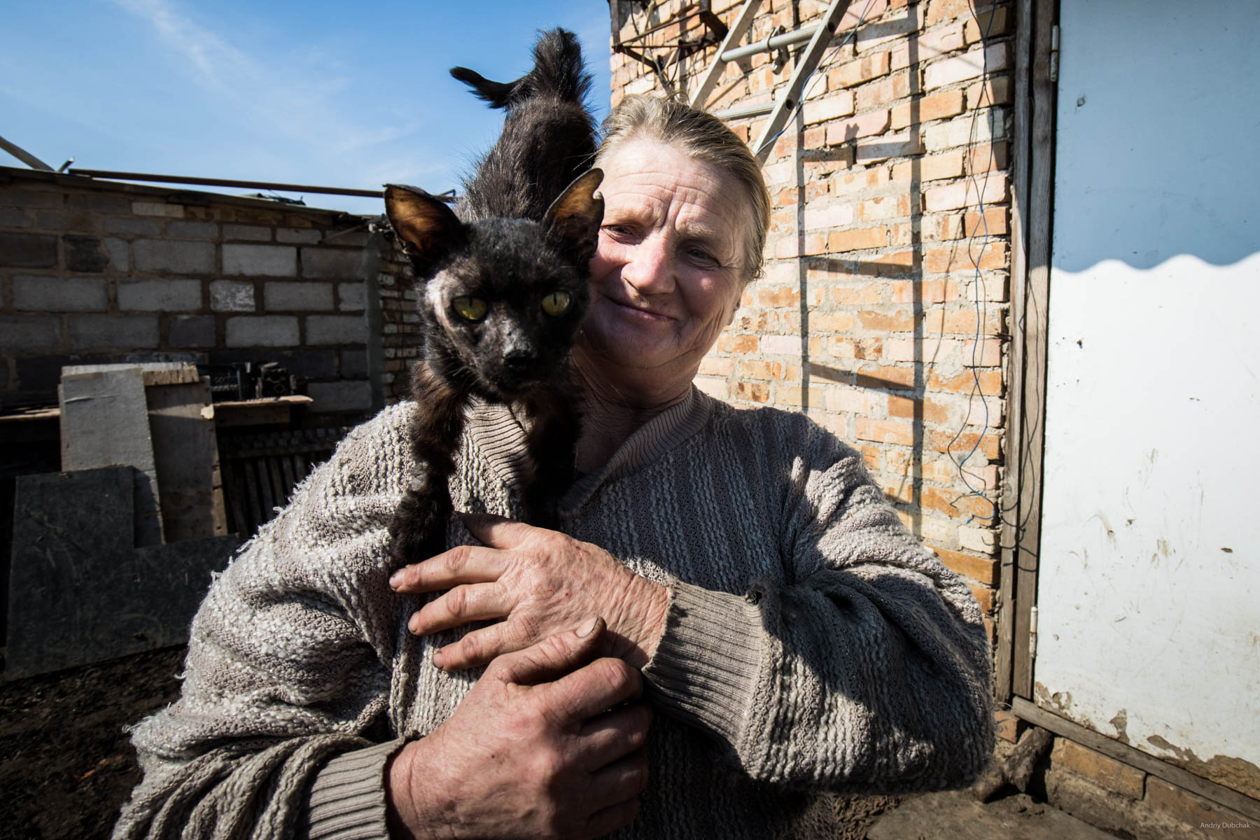 """Hello from Vodyane"". Baba Zoe with her cat Timka. The cat was wounded and ill, the woman nursed it, as she could. Vodyane, March 2018."